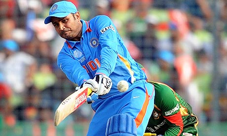 Indian cricketer Virender Sehwag hits a six against Bangladesh
