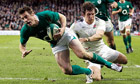 Ireland's Tommy Bowe goes over for a try against England in the Six Nations as Tom Wood tackles