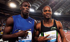 Usain Bolt (LEFT) hugs Asasfa Powell (RIGHT) after their 100M race