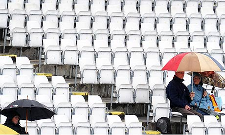 Umbrellas out as rain hits play between Durham and Lancashire at Chester-le-Street