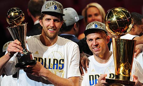 Dirk Nowitzki, left, and Jason Kidd after defeating the Miami Heat