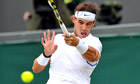 Rafael Nadal of Spain returns to Gilles Muller