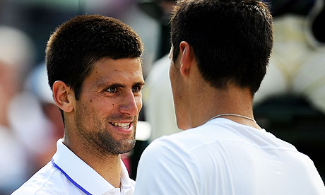 Novak Djokovic shakes hands with Bernard Tomic