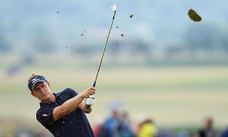 Luke Donald of England hits an approach shot