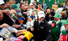 Rory McIlroy signs autographs after the final practice round for The Open
