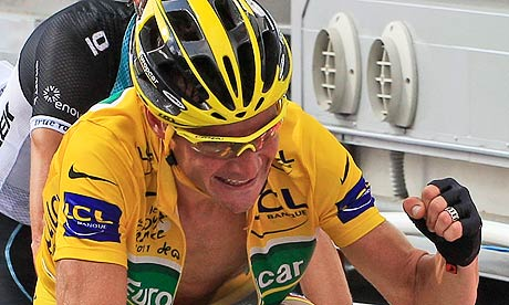Thomas Voeckler clenches his fist as he retains the yellow jersey crossing the line