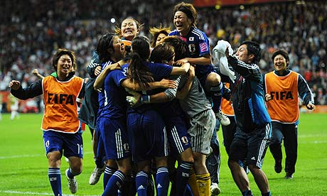Japan celebrate beating USA on penalties to win the World Cup for a first time