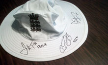 An England hat signed by the three Brisbane centurions