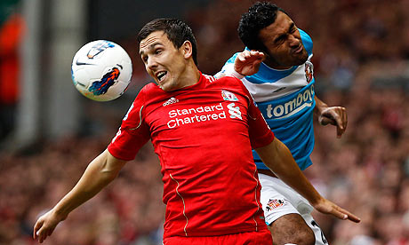 Liverpool's Stewart Downing, left, is challenged by Ahmed Elmohamady