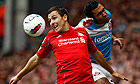 Liverpool's Stewart Downing, left