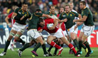Jamie Roberts of Wales drives at the South African defence in Wellington