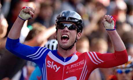 Mark Cavendish celebrates as he crosses the finish line at the UCI Road World Championships in Denmark. Photograph: Thomas Sjoerup/AP