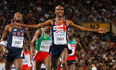 Great Britain's Mo Farah crosses the finish line to win the 5,000m