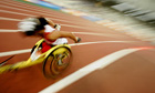 An unidentified athlete competes in the final of Women's 5000m category T54