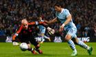 Manchester City's Sergio Agüero tries to beat the Liverpool goalkeeper Jose Reina