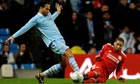 Glen Johnson of Liverpool, right, tackles Joleon Lescott of Manchester City