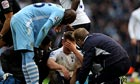 Mario Balotelli of Manchester City checks on Scott Parker