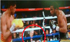 Amir Khan has questioned the presence of a mystery man in a hat at his defeat to Lamont Peterson.
