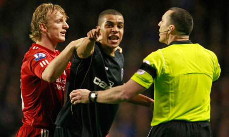 Oldham Athletic's Tom Adeyemi is calmed by Liverpool's Dirk Kuyt, left, and referee Neil Swarbrick.