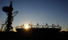 The sun sets over London's Olympic Stadium