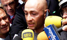 Marco Pantani speaks to a crowd of journalists
