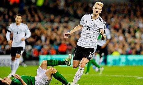 The Germany forward Marco Reus celebrates scoring his second goal against the Republic of Ireland