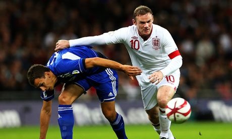 Wayne Rooney, right, grapples with Christian Brolli during England's victory over San Marino