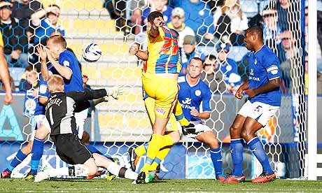 Damien Delaney, centre, scores the first goal for Crystal Palace against Leicester City