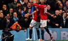 A steward is hurt as Manchester United's Javier Hernández, left, celebrates his goal against Chelsea
