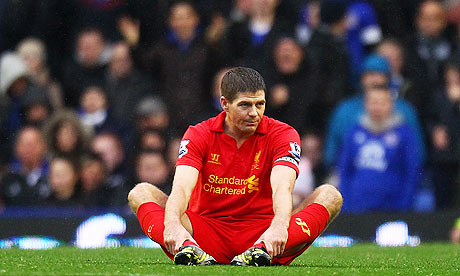 Liverpool's Steven Gerrard sits on the pitch during the game against Everton