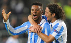 Malaga's Eliseu, left, celebrates with Manuel Iturra after scoring against Anderlecht