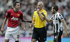 Referee Howard Webb with Newcastle United's Yohan Cabaye and Manchester United's Robin van Persie
