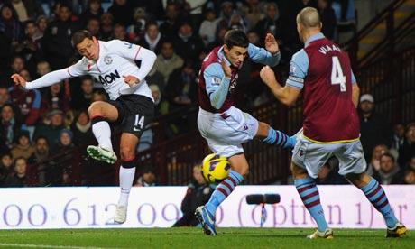 Javier Hernández's shot rebounds off Ron Vlaar of Aston Villa for Manchester United's second goal