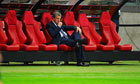 Roy Hodgson sits alone on the England bench