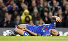 John Terry lies injured on the Stamford Bridge pitch
