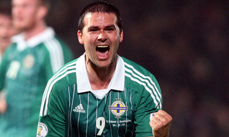 Northern Ireland's David Healy celebrates scoring in injury time against Azerbaijan at Windsor Park