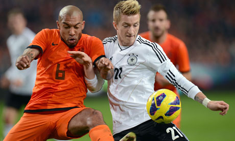 Germany's Marco Reus and Holland's Nigel de Jong fight for the ball in Amsterdam