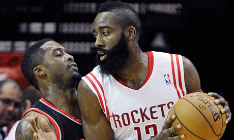 Houston Rockets' James Harden pushes up against Portland Trail Blazers' Wesley Matthews
