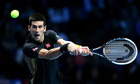 Novak Djokovic hits a backhand during his four-sets win over Andy Murray at the World Tour Finals