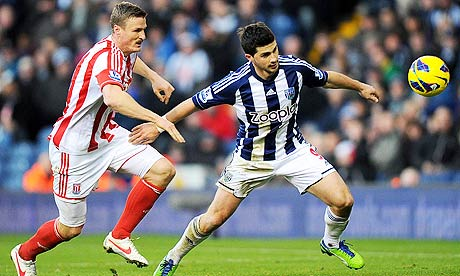 Stoke City's Robert Huth, left, and West Bromwich Albion's Shane Long