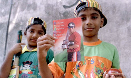 Cricket fan twins Sanju, right, and Raju display a good luck card in May 1999