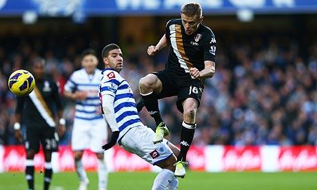 Fulham's Damien Duff wins the ball against Adel Taarabt of Queens Park Rangers