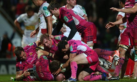 Exeter's James Scaysbrook is mobbed after his decisive try in the Heineken Cup win against Scarlets