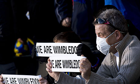 AFC Wimbledon hold placards