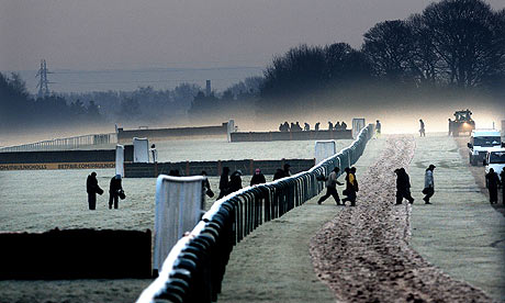 Haydock Park groundstaff out on the track in fog and frost