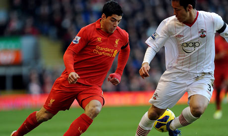 Luis Suárez of Liverpool competes with Maya Yoshida of Southampton