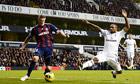 Tottenham Hotspur's Jermain Defoe, right, challenges Stoke City's Robert Huth