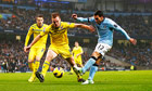 Manchester City's Carlos Tevez, right, has a shot on goal past Reading defender Alex Pearce