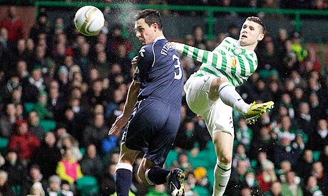 Celtic goalscorer Gary Hooper, right, in action with Ross County's Marc Fitzpatrick