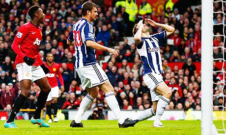 West Bromwich Albion's Gareth McAuley, right,